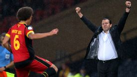 Marc Wilmots celebrates Belgium's victory over Scotland in their last World Cup qualifier.