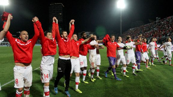 Switzerland players celebrate securing their place in Brazil.