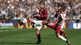 David Beckham is challenged by Rafal Siadaczka of Poland at Wembley in 1999.