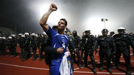 Emir Spahic celebrates after Bosnia claimed a victory that takes them to Brazil.