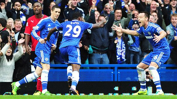 Chelsea celebrate after Samuel Eto'o fired them into the lead against Cardiff.