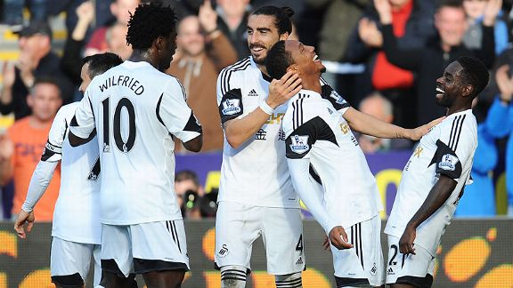 Swansea celebrate after Jonathan de Guzman netted in the rout of Sunderland.