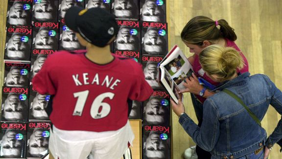 A customer at a Dublin book shop browses through a copy of Roy Keane's autobiography following its publication in 2002.