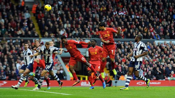 Luis Suarez heads home to complete his hat-trick against West Brom.