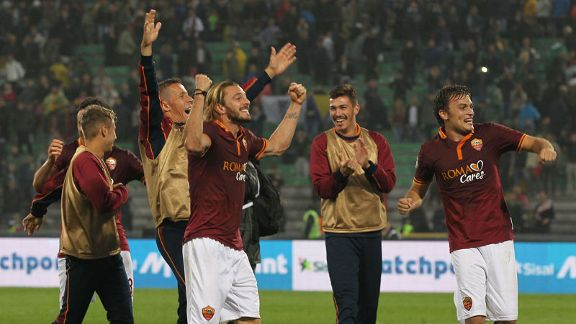 Roma celebrate after claiming a late victory over Udinese through Michael Bradley's strike.
