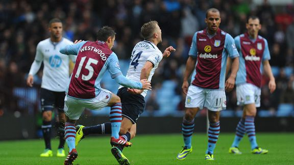 Tottenham's Lewis Holtby is tripped by Ashley Westwood of Aston Villa.