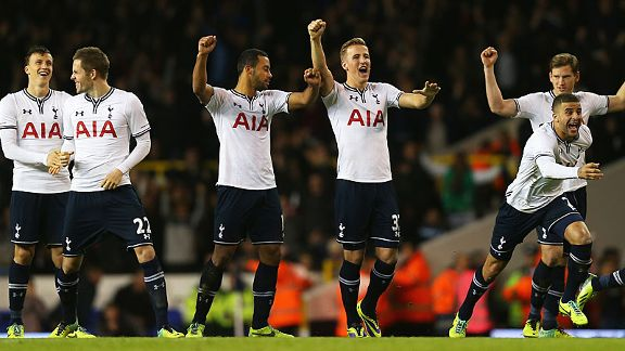 Tottenham players celebrate their shootout win over Hull City in the Capital One Cup.