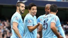 Manchester City players celebrate against Norwich.