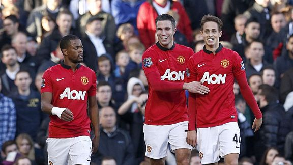 Robin van Persie celebrates after scoring against Fulham.