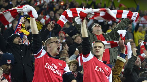 Arsenal fans celebrate as their team move towards a famous victory in Dortmund.