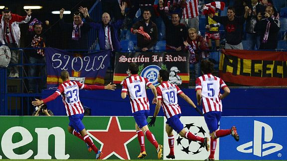 Atletico Madrid beat Austria Vienna 4-0 to secure not only qualification but top spot in their group.