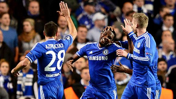 Samuel Eto'o celebrates after he scored against Schalke, with a stroke of luck.