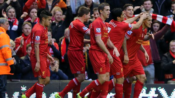 Liverpool celebrate en masse following Martin Skrtel's goal against Fulham.