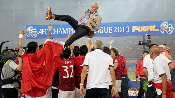 Marcello Lippi is lofted into the air after guiding Guangzhou Evergrande to the Asian Champions League title.