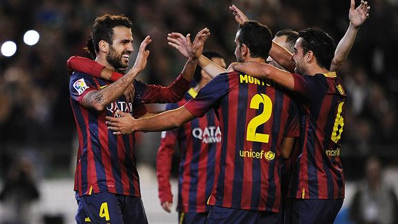 Barcelona celebrate after Cesc Fabregas ensured they took maximum points against Betis.