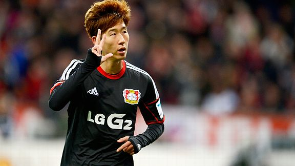 Leverkusen's Heung-Min Son celebrates his hat trick against Hamburg.