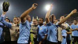 Uruguay celebrate their World Cup qualification victory over Jordan.