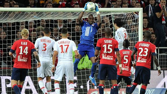 Lille's Nigerian goalkeeper Vincent Enyeama catches the ball.
