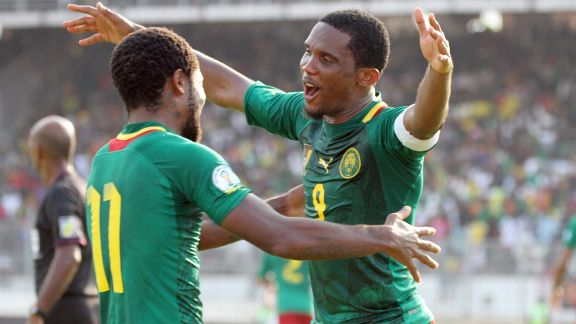Cameroon striker Samuel Eto'o (right) hugs teammate Jean Makoun after he scored against Tunisia.