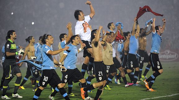 Uruguayan players rejoice after booking their ticket to Brazil.