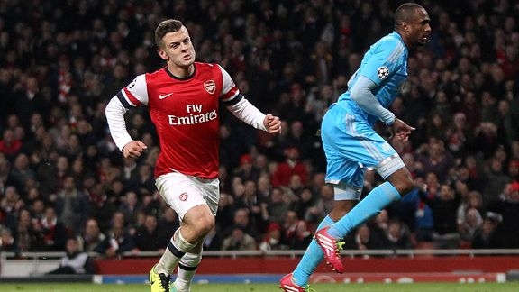 Jack Wilshere wheels away after doubling Arsenal's lead against Marseille.