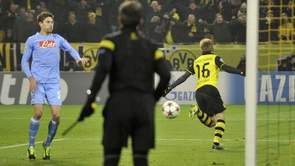 Jakub Blaszczykowski celebrates after extending Borussia Dortmund's lead against Napoli.