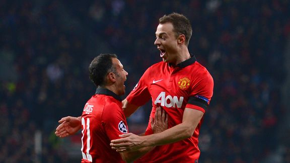Jonny Evans celebrates United's third goal against Leverkusen