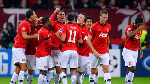 Manchester United players celebrate Chris Smalling's goal against Leverkusen.