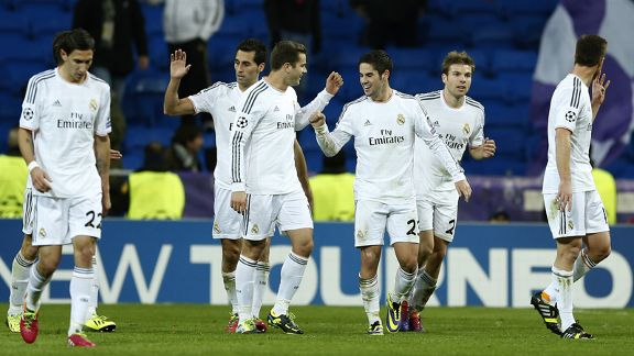 Real Madrid players celebrate a goal in their victory over Galatasaray.