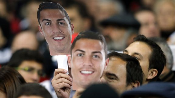 Real Madrid fans display Cristiano Ronaldo masks in backing of the player's Ballon d'Or campaign.