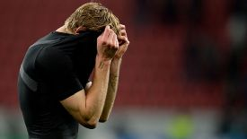 Steffan Kiessling hides his face after Leverkusen's crushing defeat to Man United.