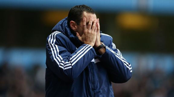 Gus Poyet woe head in hands