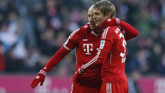 Arjen Robben and Toni Kroos celebrate during Bayern Munich's Bundesliga game against Braunschweig.