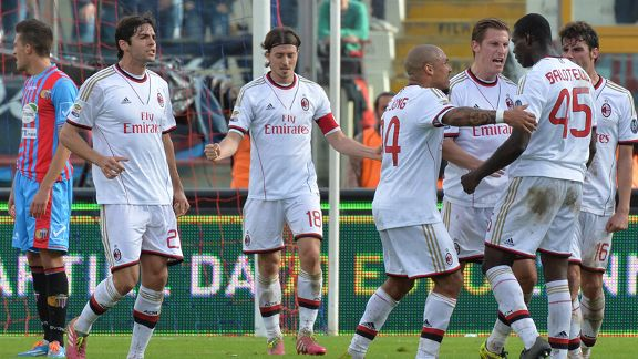 Mario Balotelli is congratulated on his goal for Milan against Catania.