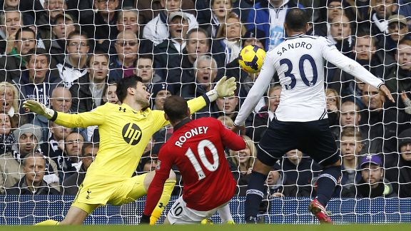 Wayne Rooney scores for Man United against Tottenham.