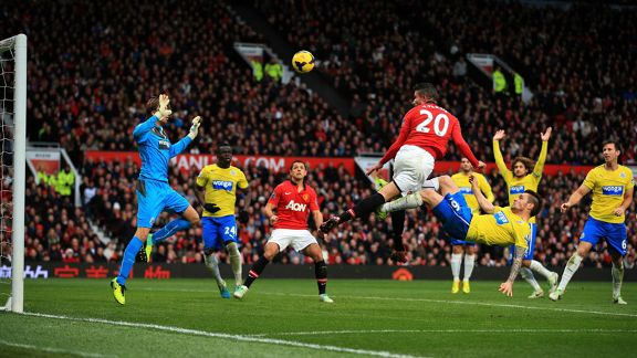 Robin van Persie heads home for Manchester United only to see his effort ruled out for offside.