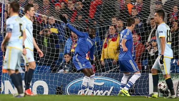 Demba Ba sweeps home Chelsea's opening goal from close range.