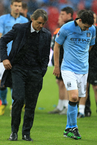 Gareth Barry was loaned out by Manchester City following the departure of Roberto Mancini as manager.