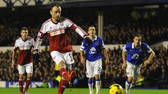 DImitar Berbatov scores a penalty for Fulham at Everton.