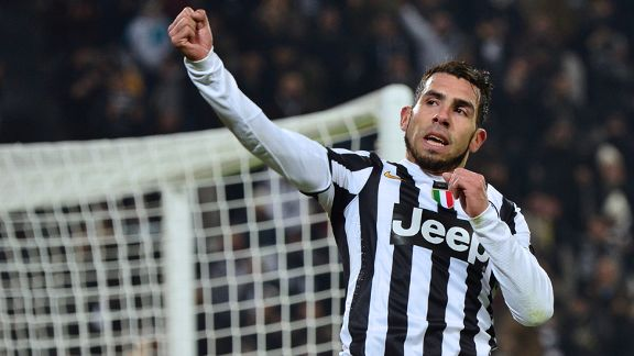 Carlos Tevez celebrates a goal for Juventus against Sassuolo.