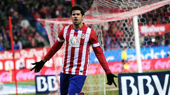 Diego Costa celebrates one of his two goals against Valencia.