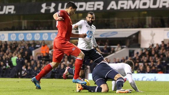 Luis Suarez opens the scoring for Liverpool at Tottenham.