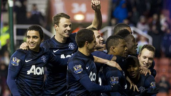 Manchester United celebrate Patrice Evra's second goal in the Capital One Cup win at Stoke.