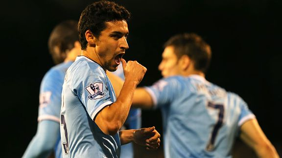 Jesus Navas celebrates after putting Man City back in front at Fulham.