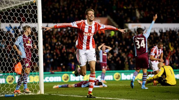 Peter Crouch celebrates after putting Stoke 2-1 in front at home to Aston Villa.