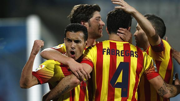 Pedro roars in celebration after scoring one of his quickfire hat trick goals against Getafe.