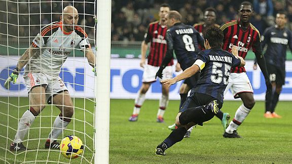 Goalkeeper Christian Abbiati is helpless as the flick from Rodrigo Palacio (8) tickles into the net.