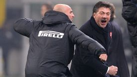 Esteban Cambiasso celebrates with coach Walter Mazzarri after Rodrigo Palacio's late winner in the Milan derby.