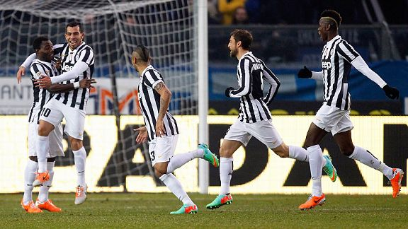 Juventus celebrate after Carlos Tevez put them in front at Atalanta.