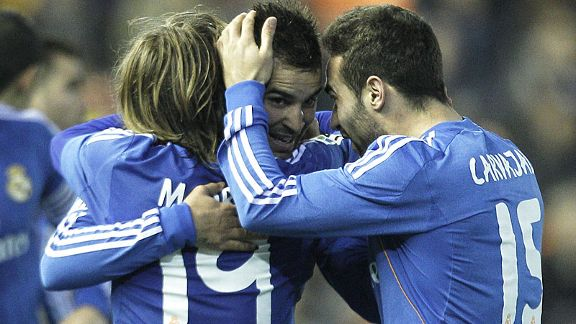 Jese is mobbed after scoring the goal which earned Real Madrid a vital 3-2 win at Valencia.